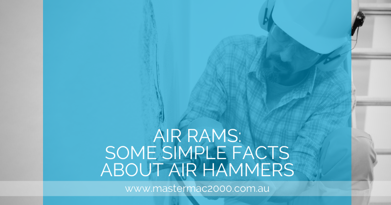 worker uses air hammer chisel